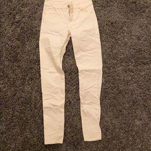 Very light yellow skinny jeans